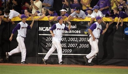 ECU Baseball Team celebrates with the die hard fans in the Jungle.
